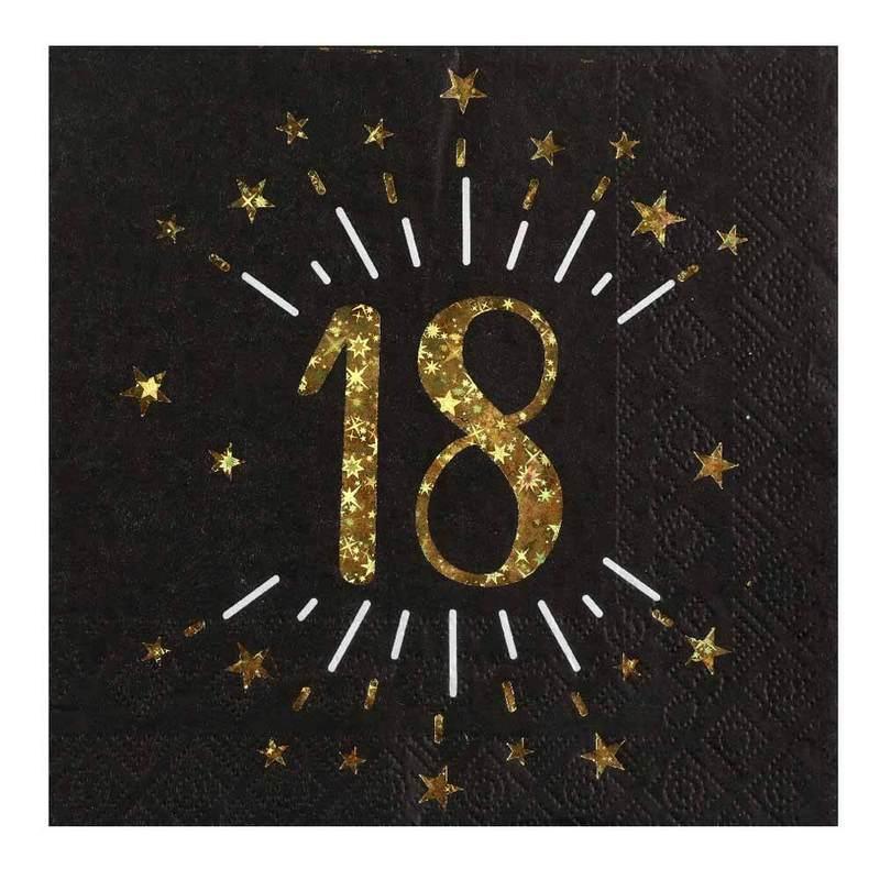 Zlaté číslo osmnáct na černém ubrousku.
